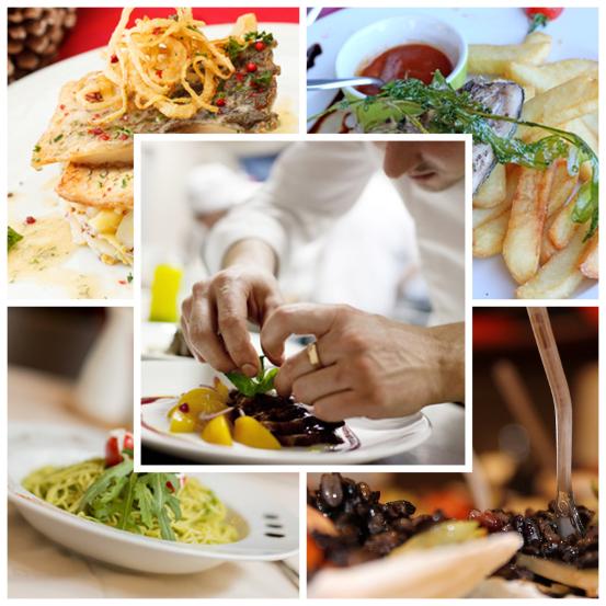 Le mani dello chef lavorano con cura i quattro deliziosi piatti di pesce e verdure della tradizione mediterranea